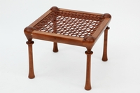Four legged walnut stool or Diphros with interlaced leather straps inside the frame